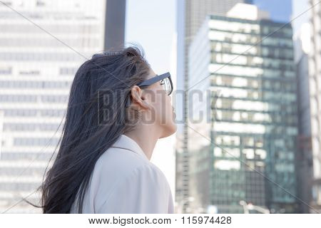 Young Hispanic Professional Woman With Glasses