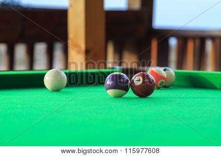 Billiard Balls On The Green Pool Table