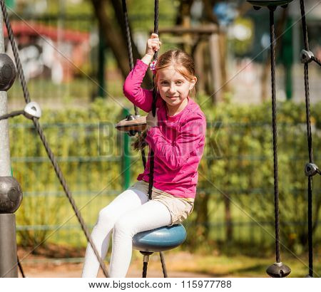 cute happy little girl on outdoor playground