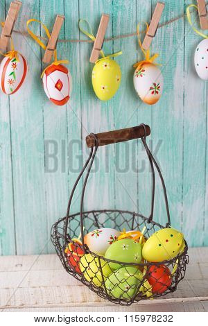 Decorative Easter Eggs In Bucket And On Clothes Line.