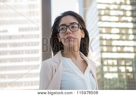 Hispanic Young Professional Woman With Glasses In The City
