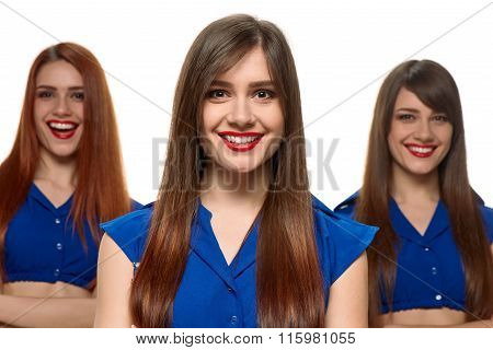 group of three smiling women. triplets sisters