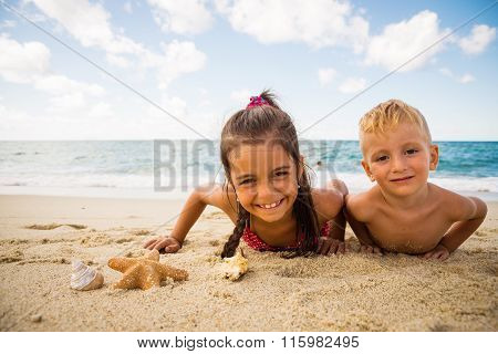 Children Playing With A Starfish On The Beach