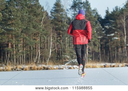 Man during sport trail running race in winter outdoor