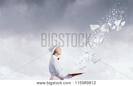 Astonished woman looking in book