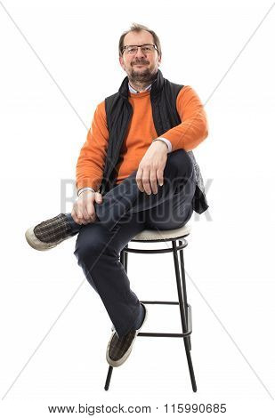 Confident male model with crossed legs.