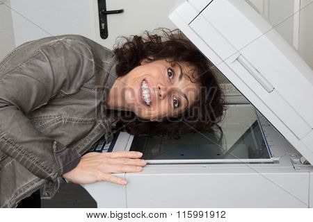 Smiling Girl Checking Scanner Photocopier Machine Putting Her Head Inside