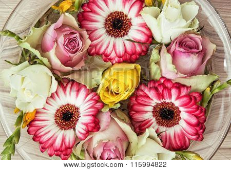 Roses And Gerberas Flowers In The Glass Bowl With Water, Holiday Symbol