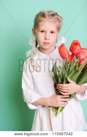Child girl with flowers