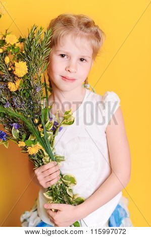 Cute kid girl with flowers