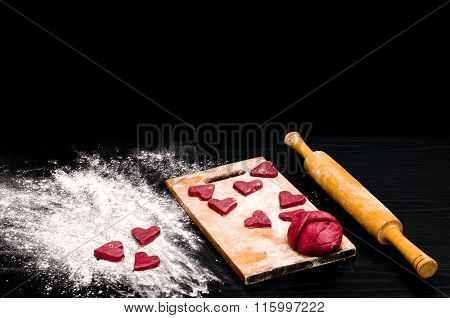 Red Heart Cookies On A Black Table, Baking For Valentine's Day