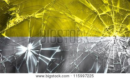 Flag of the Catholic Church painted on broken glass