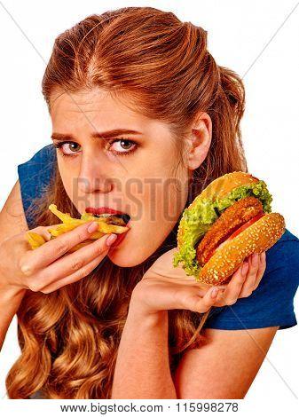 Portrait girl eat fastfood hamburger and fried potatoes.