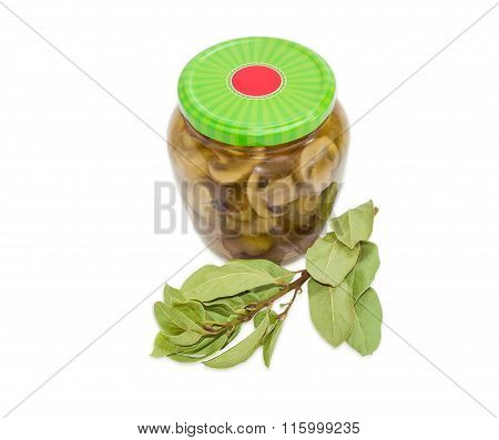 Pickled Mushrooms In Glass Jar And Branch Of Bay Laurel