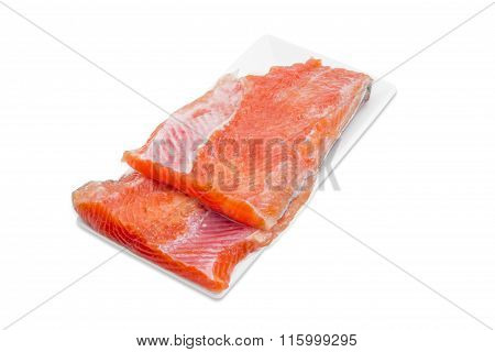 Uncooked Fillet Of Rainbow Trout On A Rectangular Dish