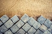 Постер, плакат: Construction Of Pavement Details Cobblestone Pavement Stone Blocks On Road Construction Site