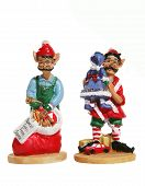 stock photo of  midget elves  - colorful santas elves at christmas over white - JPG