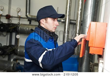 maintenance repairman engineer operating of heating system equipment in a boiler house