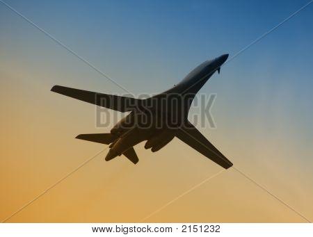 Military Aircraft In Flight At Dawn