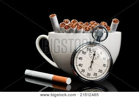 Cup Full Of Cigarettes And Stopwatch