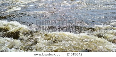 Small eddy in a flowing river