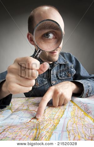 Funny Tourist Discovering Map