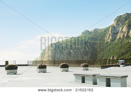 Area With Benches And Flowerbeds Near Montserrat Mountain, Catalonia, Spain