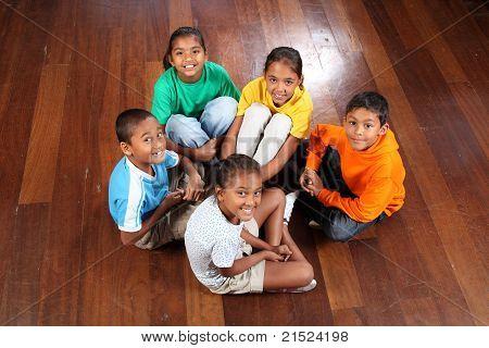 Five children in classroom floor