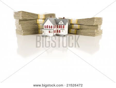 Stacks of One Hundred Dollar Bills with Small House on Slight Reflective Surface.