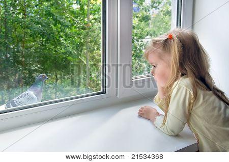 Sad child at the window.