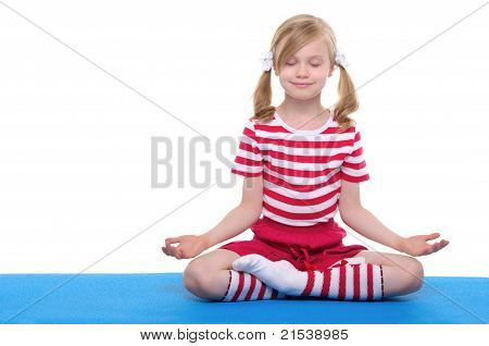 girl with eyes closed practicing yoga