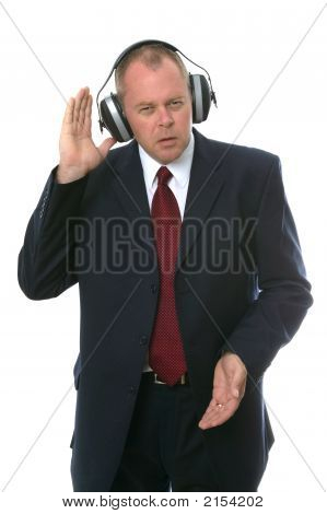 Businessman In Earphones