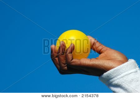 Black Hand With Yellow Ball