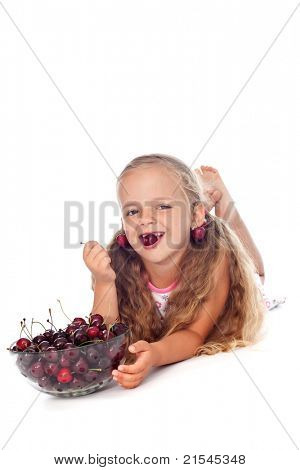 Healthy seasonal fruit snack - little girl with summer cherries in a bowl, isolated