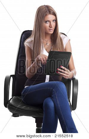 Beautiful Woman In Chair With Tablet Computer