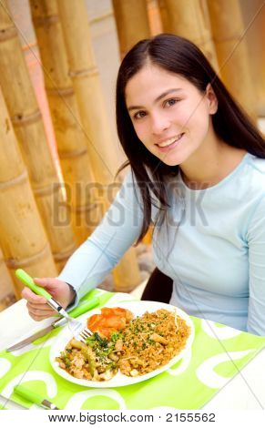 Girl Eating In A Restaurant