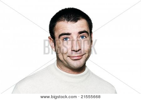 Portrait of a handsome expressive bored man in studio on white isolated background