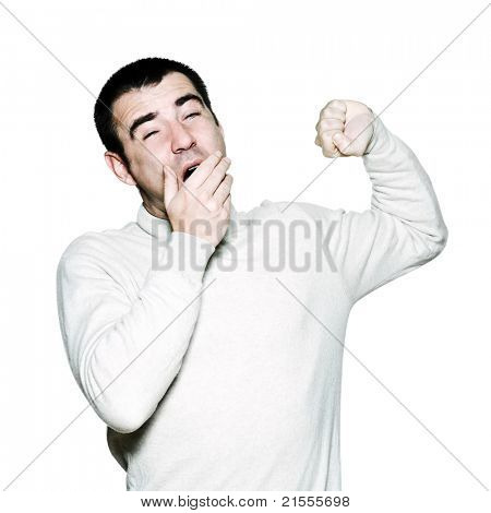 Portrait of a handsome expressive man yawing in studio on white isolated background