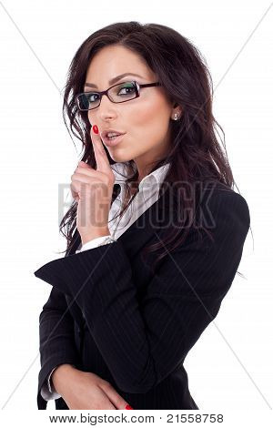 Business Lady In Suit Holding Her Finger Near The Mouth