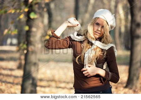 Outdoor Portrait of Beautiful Blond Young Woman in Park