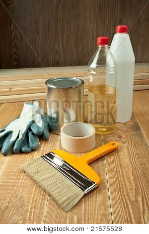 Painting tools on wooden floor.