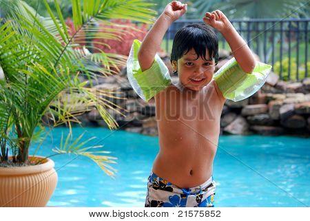 An adorable Hispanic boy in the pool