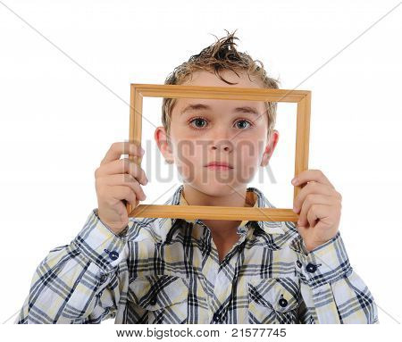 little boy with a frame in his hands