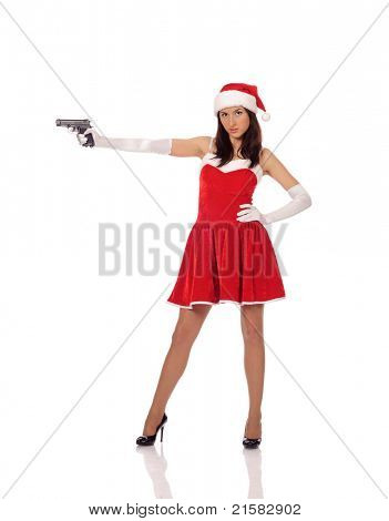pretty young teenager in red christmas clothing with the gun, isolated on white