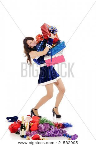 pretty young teenager in blue christmas clothing with a lot of presents, isolated on white.