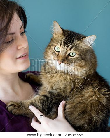Young Woman With Pet Cat