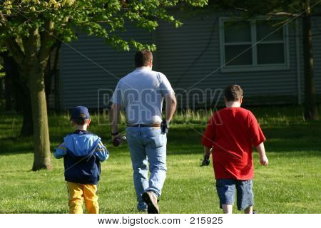 Father And Sons Walking Away