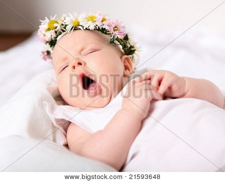 Portrait of a yawning baby girl