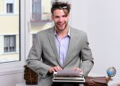 Writer Or Businessman Wearing Grey Suit. Young Author Or Editor poster