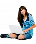 Confident Teenage Girl Using A Laptop